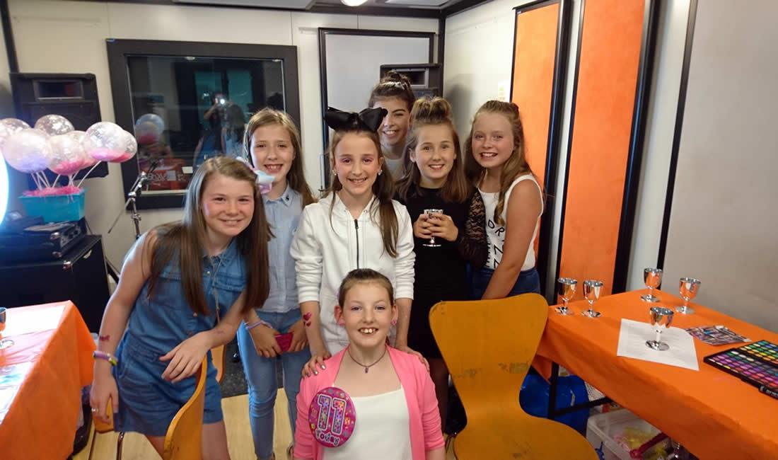 Group of girls at music studio party