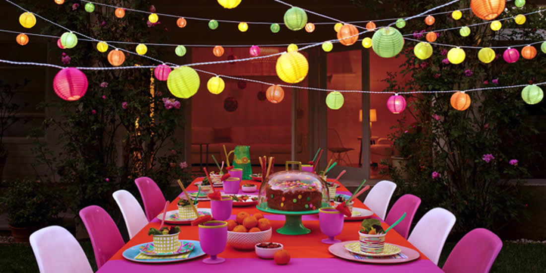 Large party table with brightly coloured lanterns above